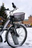 Bike after a snowfall on winter area Stock Images