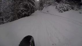 Bike on snowy road stock footage