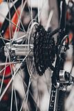Bike speed changing assembly. Rear wheel. Steel bicycle chain. Transmission gears close-up.  Royalty Free Stock Photography