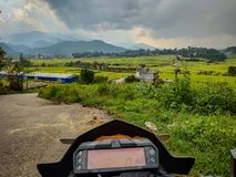 Bike speedometer with stunning landscape and meadow royalty free stock images