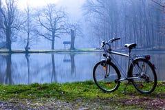 Bike in spring morning. Bike in fog at pond, spring morning stock image