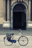 Bike in a square in front historic building. Nobody Royalty Free Stock Photography