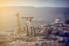 Bike standing on mountain on sunny day stock photography