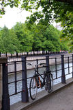 Bike standing at a railing on a promenade on the banks of the River Spree Stock Photo