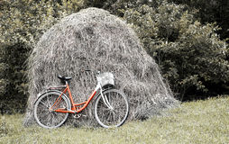 Bike stands against a haystack. Rural landscape Royalty Free Stock Photography