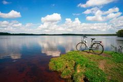 Bike stands on the banks of the lake. Royalty Free Stock Photos