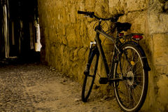 Bike on the street. Bicycle in the street near a brick wall royalty free stock photography