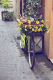 Bike in the street. Bike with flowers in the street of Rome Royalty Free Stock Photos