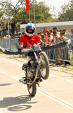 Bike stunt. Show with biker showing the stunt. This event is held on 06-03-2009 in auto mall show in Chandigarh India. This event is mainly done to show the royalty free stock photos