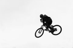 Bike stunt jump. A bike stunt jump in the air Stock Image