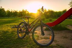Bike at the summer sunset in the park. Cycle closeup wheel on bl stock photo