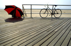 Bike,sun shade at the beach. Sport bike, red/black sun shade at Coney Island New York U.S.A stock photos