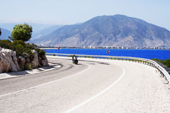 Bike on a sunny coastline road Royalty Free Stock Image