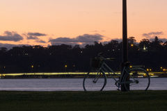 Bike in sunset. Retro bike in sunset leaning on lamppost Royalty Free Stock Photography