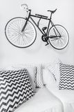 Bike suspended on the wall. In modern interior stock photos