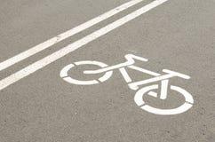 Bike symbol on asphalt Royalty Free Stock Images