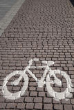 Bike Symbol on Cobbled Stone Royalty Free Stock Image