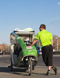 Bike taxi in berlin,man and rickshaw Stock Photo