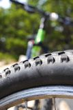 Bike tire. Front tire on mountain bike Royalty Free Stock Photos