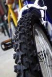 Bike tire closeup detail. Closeup detail of a bike tire with new tread stock photos