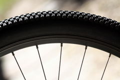 Bike Tire and Spokes. Bike wheel portion with a view of the tire and spokes stock photos