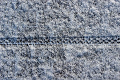 Bike tire track in snow Royalty Free Stock Images