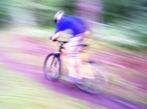 Bike to Lightspeed. Racing through the forest at the speed of light Royalty Free Stock Images