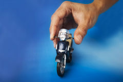 Bike toy. Hand playing with bike toy Stock Photo