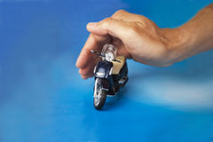 Bike toy. Hand playing with bike toy Royalty Free Stock Photos
