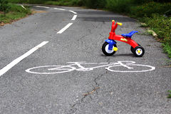 A bike toy on bike lane Royalty Free Stock Photos