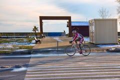 Bike training in spring on asphalt road. Russia, Olympic village - January 31, 2017: bike training in spring on asphalt road stock photo