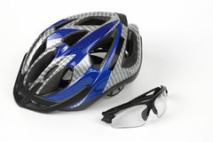 Bike transparent glasses on the background of the helmet. The bike transparent glasses on the background of the helmet Stock Photography