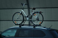 Bike transportation bike on the roof of a car royalty free stock photos