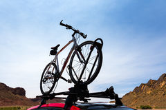 Bike transportation on the roof of a car. Stock Images