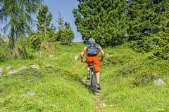 Bike traveller uphill Stock Image