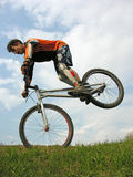 Bike trick. Man on first weel Royalty Free Stock Photography