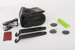 Bike tyre tube puncture repair tool kit. Set of tools for repairing punctured tube, isolated on white background, studio photo stock photo