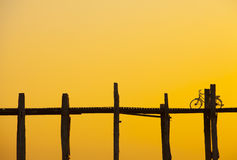 Bike on U Bein Bridge at sunset Royalty Free Stock Photography