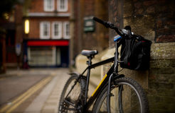 A bike in University of Cambridge. Shoot in University of Cambridge, a bike parked on the street Stock Photography