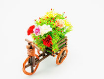 Bike vase. Plastic flower on a bike vase with white background Royalty Free Stock Images