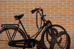 A bike with a wall. A bike with a brick wall background Stock Images