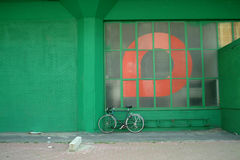 Bike at the wall. Bike at a green wall stock photography
