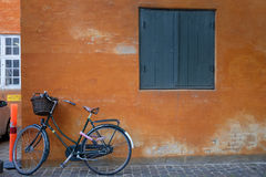 Bike at wall. Bike at an orange wall Stock Photo