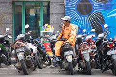 A bike watcher working beside a street in Banding, Indonesia Royalty Free Stock Photo