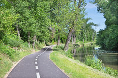 The bike way alongside the river in Bernolakovo. Royalty Free Stock Photos