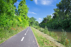 The bike way alongside the river in Bernolakovo. Royalty Free Stock Images