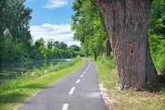 The bike way alongside the river in Bernolakovo. Royalty Free Stock Photos