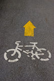 Bike way sign on the road. In the park Royalty Free Stock Photography