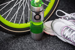 Bike weel, bottle and sport shoes Royalty Free Stock Image