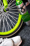 Bike weel, bottle and sport shoes Stock Photos